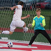 VON CASTOR/Phoenix Special Photo<br /> Fort Gibson's Carter Lawson scores on a shot past the Verdigris goalkeeper Friday night.