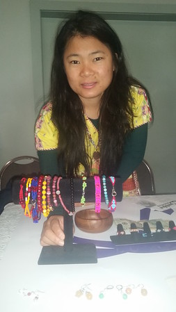 Myanmar refugee Yuree Lembke shows jewelry she made to help raise money for a mission trip to help other refugees from her home country. She said she has only a few pieces left.