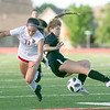 VON CASTOR/Special to the Phoenix<br /> Fort Gibson's Albany Adair, left, and Verdigris' Megan Turner collide as they battle for ball possession Saturday in quarterfinal action in the Class 4A girls soccer tournament at Verdigris. The Lady Tigers lost 2-1.