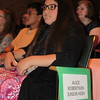 Staff photo by Cathy Spaulding<br /> Alice Robertson Junior High seventh-graders Phuong Nguyen, left, and Lauren Torres listen during the Muskogee Public Schools academic honors program Thursday night at Muskogee High School. The two had top grades in their classes.