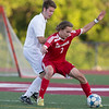 Phoenix special photo by Von Castor<br /> Fort Gibson's Micah Page, right, holds off a Holland Hall defender to gain possession of the ball during Friday's Class 4A quarterfinal match, won 2-1`by the Tigers at Holland Hall High School.