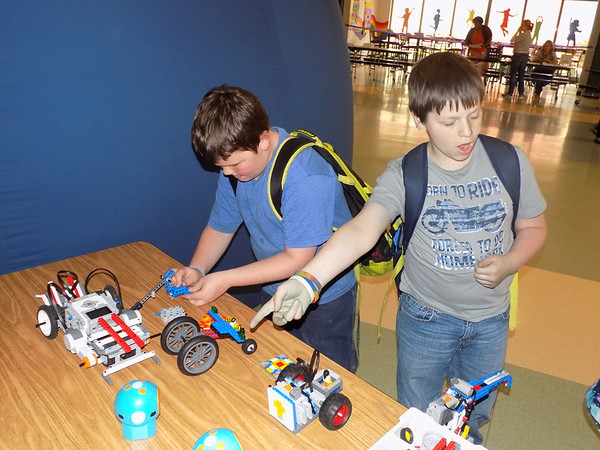Special photo by Mike Elswick<br /> Davin Moore, fourth grader, and Alexzander Avers work with robotics models at Whittier Elementary's open house and grand opening for the school's new Jimmie Johnson Champions Foundation Family Resource Center.
