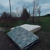 KENTON BROOKS/Muskogee Phoenix<br /> Two mattresses were left on the side of the road by 54th Street near the Muskogee landfill.