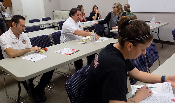 MIKE ELSWICK/Muskogee Phoenix<br /> First responders in a training session held by Cherokee Nation officials last week were taught how to properly recognize an opioid overdose and how to treat it when they are on the scene. The training was held at the Nonprofit Resource Center.