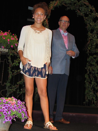 Staff photo by Cathy Spaulding<br /> Hilldale student Catelin King models a summer skirt set while Mayor Bob Coburn shows a hibiscus-hued shirt and seersucker tie Friday at the Salvation Army Women's Auxiliary Style Show and Luncheon. The luncheon raised money to help send children to camp.