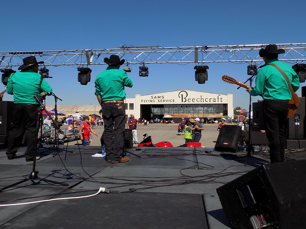 Special photo by Mike Elswick<br /> One of several bands performing during Saturday's community-wide Cinco de Mayo festival are seen on stage with the crowds, dancers and hangar in the background.