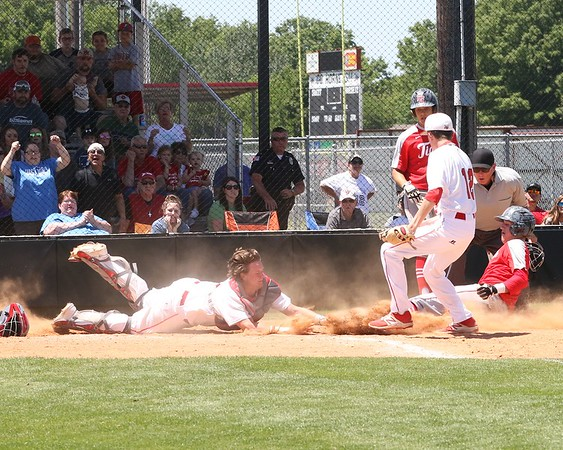 Phoenix special photo by John Hasler<br /> Hilldale's Kort Morgan, left, tags out Fort Gibson's Brandon Downey in the bottom of the third inning during Saturday's Class 4A regional championship game at Hilldale High School. The Hornets beat the Tigers 3-2 in eight innings to earn their first state tournament berth since 2012.