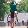 Phoenix special photo by Von Castor<br /> Muskogee's Shatazia Cleveland leaps a distance of 14 feet, 4 3/4 inches to finish seventh in the long jump at Saturday's Class 6A regional track meet at Claremore.