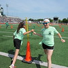 Tony Goetz Elementary student Aubree Davis, right, passes a baton to Savanah Wilson during relays.