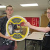 CATHY SPAULDING/Muskogee Phoenix<br /> Fort Gibson Hostile Gato teammates Whittman Abbott, left, and Hunter Bartlebaugh show a souvenir they got while competing in FIRST Robotics contests.