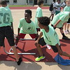 Tony Goetz Elementary students Damion Robinson, second left, and Kash Green, third left, get some leg stretches in.