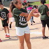 CATHY SPAULDING/Muskogee Phoenix<br /> Jaylee Sallis of Creek Elementary stretches her arms before competing. Students from each elementary school in Muskogee Public Schools tried their skills at various events Monday during the annual Elementary Track Meet.