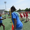 Ben Franklin STEM Academy student Brooklynn Ragsdale, left, prepares to pass a baton to teammate Rachrisia Brown.