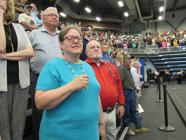 Staff photo by Cathy Spaulding<br /> Charlotte Vaughn of Muskogee, left, watches for her son, Matthew Kirby, in the Northeastern State University commencement processional Saturday afternoon. She said Kirby graduated summa cum laude with a degree in English.