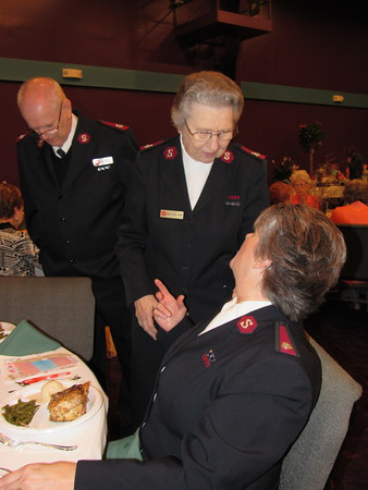 Staff photo by Cathy Spaulding<br /> Major Patricia Robbins, center, talks with Major April<br /> Taylor, associate area commander of the Tulsa Salvation<br /> Army, while Major James Robbins pauses. The Robbins<br /> are interim commanders of the Muskogee Salvation Army