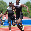 Phoenix special photo by Von Castor<br /> Muskogee's Tyriq Beasley, left, hands off to Kamren Curl heading into the third leg of the boys 400 meter relay at Saturday's Class 5A-6A regional track meet at Tahlequah High School. The team won the event in a photo finish over Broken Arrow, Midwest City and Tulsa Union to advance to next week's state meet.