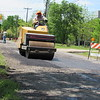 CATHY SPAULDING/Muskogee Phoenix<br /> City worker Clarence McBride smoothes asphalt along Kalamazoo Street west of Sixth Street.