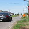 CATHY SPAULDING/Muskogee Phoenix<br /> A car pulls to a stop at 24th Street and Military. The City of Muskogee has plans to widen 24th Street.
