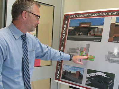 CATHY SPAULDING/Muskogee Phoenix Wagoner School Superintendent Randy Harris shows plans for classroom wings at Ellington Elementary, part of a $19.9 million bond issue voters will decide on Tuesday.