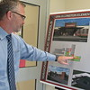 CATHY SPAULDING/Muskogee Phoenix<br /> Wagoner School Superintendent Randy Harris shows plans for classroom wings at Ellington Elementary, part of a $19.9 million bond issue voters will decide on Tuesday.