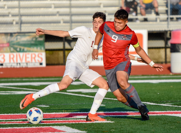 CHRIS CUMMINGS/Phoenix Special Photo Jose Estrada attempts to recover the ball from Crooked Oak's Jacob Ramos in Tuesday's Class 4A soccer semifinal at Leo Donahue Tiger Stadium. Fort Gibson won and will go for a third consecutive state championship later this week.