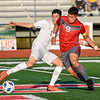 CHRIS CUMMINGS/Phoenix Special Photo<br /> Jose Estrada attempts to recover the ball from Crooked Oak's Jacob Ramos in Tuesday's Class 4A soccer semifinal at Leo Donahue Tiger Stadium. Fort Gibson won and will go for a third consecutive state championship later this week.