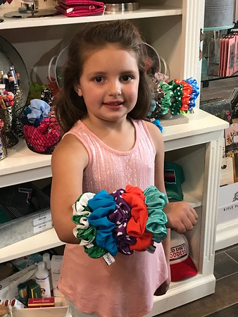 ANDREA CHANCELLOR/Special to the Phoenix<br /> Loaded up with scrunchies to make a retro fashion statement.