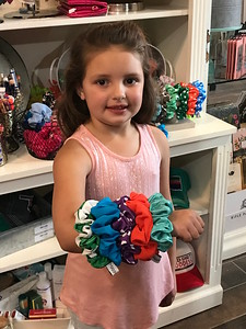 ANDREA CHANCELLOR/Special to the Phoenix Loaded up with scrunchies to make a retro fashion statement.