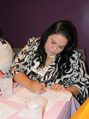 Staff photo by Cathy Spaulding<br /> Marcella Paige works on figures during a recent style show and luncheon sponsored by the Salvation Army Women's Auxiliary.