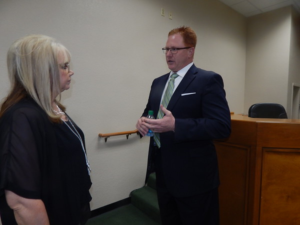 KENTON BROOKS/Muskogee Phoenix<br /> Dr. Jarod Mendenhall, the new superintendent of Muskogee Public Schools, meets with secretary Carla Cooper after the board meeting.
