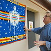 CATHY SPAULDING/Muskogee Phoenix<br /> Five Civilized Tribes Museum Executive Director Sean Barney shows how a Pendleton wool blanket made by artist Virginia Stroud still has some horse hairs. He said former Cherokee Nation Principal Chief Wilma Mankiller donated the blanket to the museum.