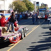 Staff photo by Mark Hughes<br /> A young girl supporting the American Legion Auxiliary Post 15, tosses candy to children along side the street. In the parade were floats, a miniature Sherman tank replica, horses, dogs, firetrucks, bands, classic cars, motorcycles and more.