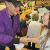 "Staff photo by Cathy Spaulding<br /> Vietnam veteran H.R. ""Chris"" Ford, left, shakes hands after Fort Gibson schools' Veterans Day assembly. Ford, who was wounded Nov. 11, 1966, received cards and handshakes of gratitude after the assembly."