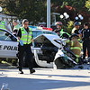 Staff photo by Harrison Grimwood<br /> First responders extricate a Muskogee police officer Tuesday afternoon when he was pinned following a head-on collision.