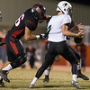 Phoenix special photo by Von Castor<br /> Hilldale's Hunter Reheard makes contact with the Catoosa quarterback and causes a fumble in the Indians' very first play last Friday. Hilldale took advantage of five Catoosa turnovers in a 51-7 first-round win.
