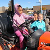 Staff photo by Cathy Spaulding<br /> Ben Franklin Science Academy first-grader Dorya Shumate takes the wheel of a front-end loader during the tour of types of transportation.