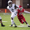 Phoenix special photo by Shane Keeter<br /> Muskogee's Kamren Curl runs the ball while being chased by Lawton's Stephen Silas during the Roughers 35-28 loss on Friday at Edmond Santa Fe High School.