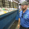 Staff photo by Cathy Spaulding<br /> Marc Herringshaw walks past a bin loaded with plastic bottles. Herringshaw's business seeks to do more recycling.