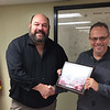 Photo by D.E. Smoot<br /> Muskogee County Sheriff Charles Pearson, left, receives a plaque that was presented Monday by 911 Coordinator Darryl Maggard.