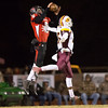 Phoenix special photo by Von Castor<br /> Hilldale's Jaron Nail, left, comes up with an interception while playing safety against Clinton. Nail, who played safety all season but was thrust into duty at quarterback in week 10 due to injury, will play both next season from the start.