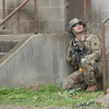 Staff photo by Mark Hughes<br /> Checking out windows in a nearby two-story building for potential enemy activity is a member of Oklahoma's 1st Battalion, 179th Regiment, 45th Infantry Brigade Combat Team. The team is concluding two weeks of training at Camp Gruber Joint Training Facility. About 250 guardsmen will deploy in January to Ukraine for a six-month training mission.