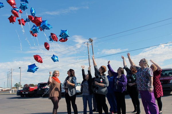 Special photo by Travis Sloat<br /> A group of Cima Hospice employees and administration,<br /> as well as Marcy Price, whose mother was in hospice care, release balloons to honor patients the hospice has served.