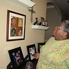 Staff photo by Cathy Spaulding<br /> Lisa Dedmon keeps family photos on her walls and tables. She said she is motivated by a commitment to her family.