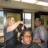 Staff Photo by Cathy Spaulding<br /> Lisa Dedmon, right, watches Elite Beauty College student Aspen McDonald comb and cut Lorie Byrd's hair. Dedmon has a lifelong passion for cosmetology.