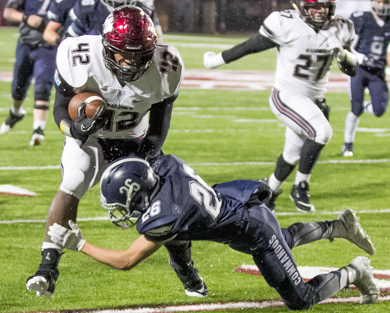 Phoenix special photo by Shane Keeter<br /> Wagoner's K.J. Lee, left, gets away from Cascia Hall's Dalton Turner during Friday's Class 4A semifinal at Jenks. The Bulldogs won 54-20 and will face Oologah in the championship next week, a rematch of the 2014 game won by Wagoner 45-21.