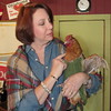Staff photo by Cathy Spaulding<br /> Jennifer Crotty pets a family hen, Honey Boo Boo. A friend of Crotty's made the chicken's vest.