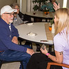 Special photo by Travis Sloat<br /> Former EASTAR Health System physical therapy patient Tommie<br /> Howdeshell visits with Charla Scott, a physical therapy assistant,<br /> at an annual reunion of physical therapy patients. Howdeshell said<br /> the event, held at the main EASTAR campus, gave him a lot of joy.