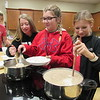 Staff photo by Cathy Spaulding<br /> Hilldale eighth-graders, from left, Cali Wallis, Madeline Parpart and Addysyn Asmus prepare a potato soup for Friday Food Lab. Patty McAllister offers the food lab in each class.