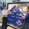 "CATHY SPAULDING/Muskogee Phoenix<br /> Muskogee High School Air Force Junior ROTC Cadet Capt. Blake Simmons, left, and Cadet Lt. Col. Jacine Crosby hold one of the flags cadets carry in parades. The MHS unit received an ""Exceeding Standards"" rating in late October."