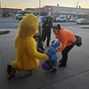 "CHESLEY OXENDINE/Muskogee Phoenix<br /> Dezirai White, 2, checks out Sesame Street's Big Bird with Briana Wacoche at Muskogee County Emergency Medical Service's Halloween Extravaganza on Thursday night. The event was a way for parents and kids to celebrate Halloween — and get some candy — in a ""safer, controlled area,"" said Muskogee County EMS Community Relations Coordinator Trish German."